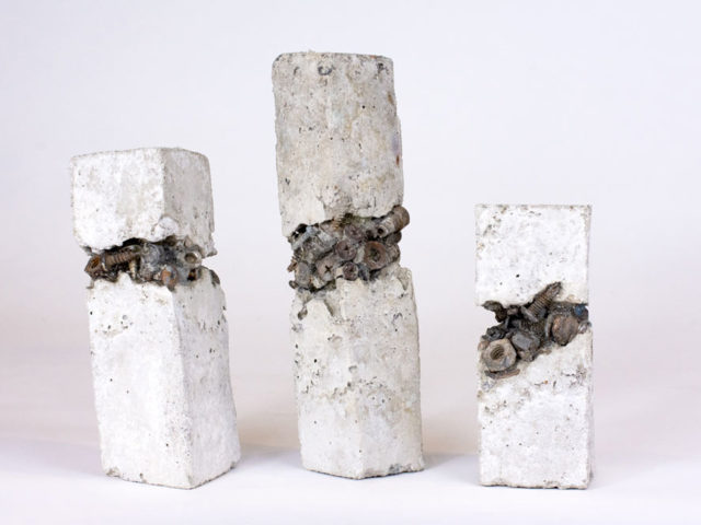 Concrete sculptures with nuts and bolts embedded in the centres