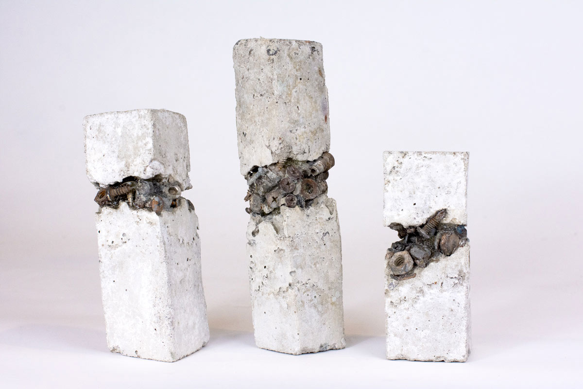 Concrete sculptures with nuts and bolts embedded in centre