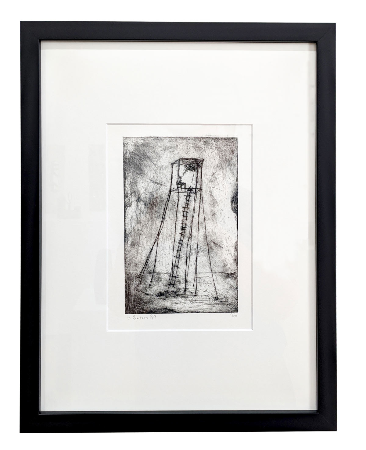 Framed etching depicting a chair in a tower