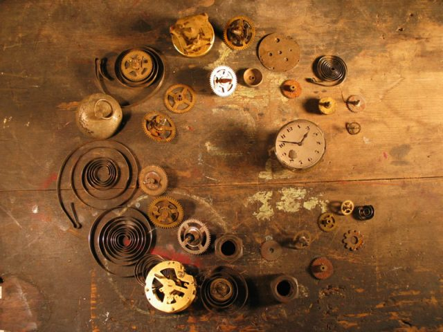 Clock parts on wooden background