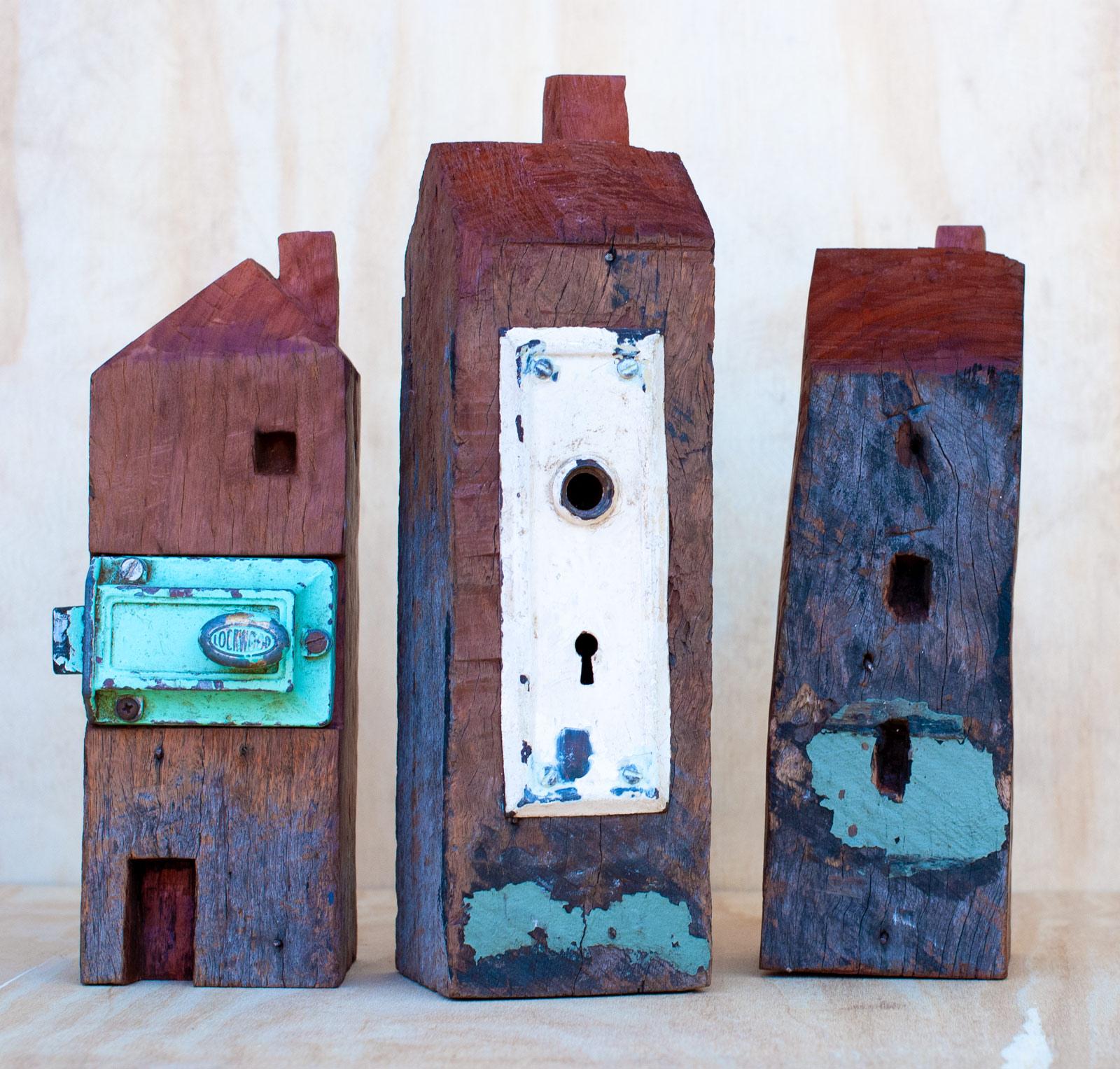 Three redwood house sculptures by Ingrid K Brooker