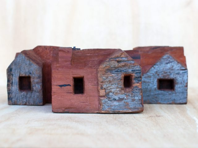 Carved red gum houses by Ingrid K Brooker