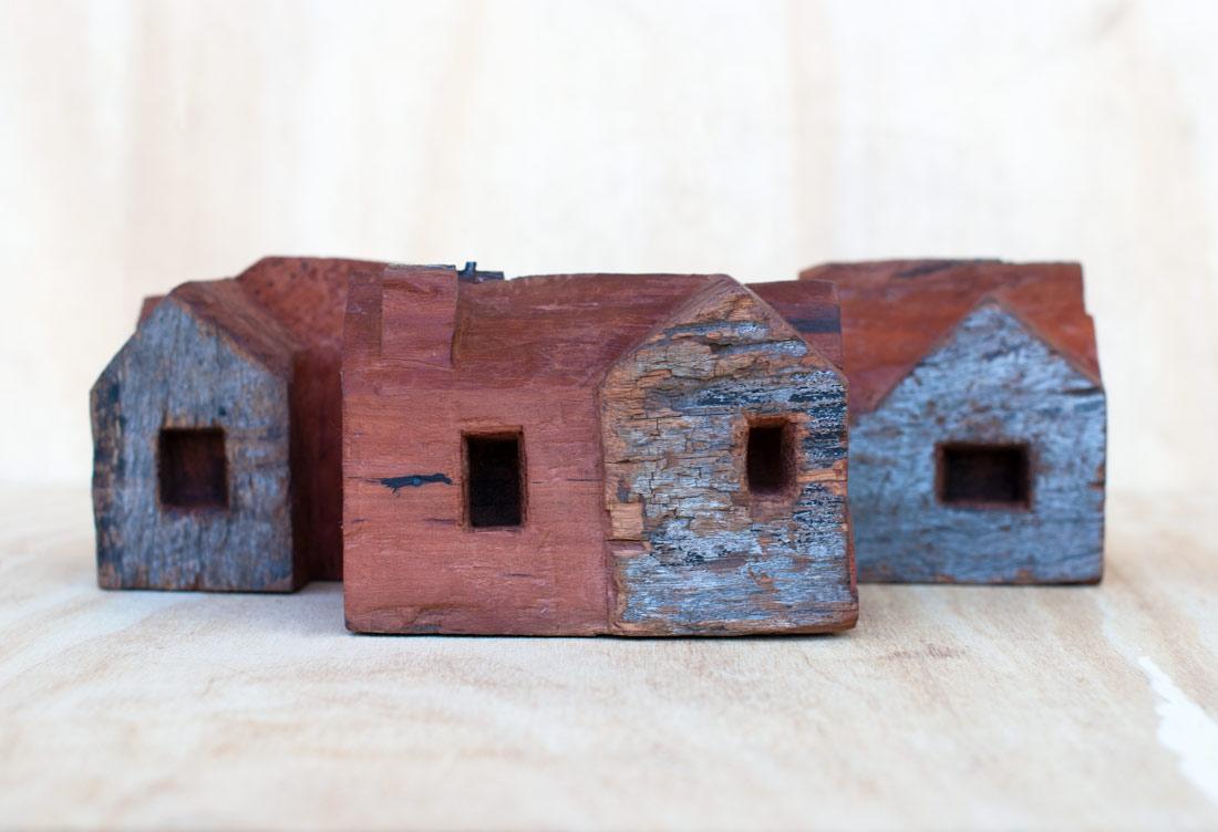 Carved red gum houses by Ingrid K Brooker