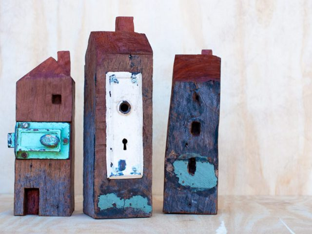 Three redgum house sculptures by Ingrid K Brooker