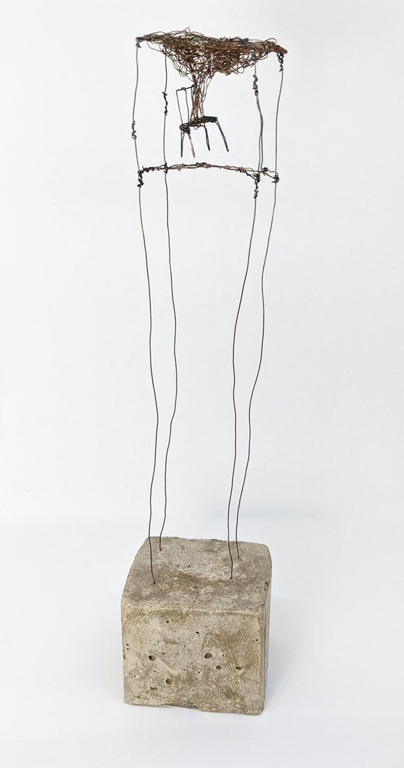 Wire and concrete sculpture of chair in cube with cloud coming from chair