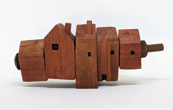 Carved red gum house sculpture