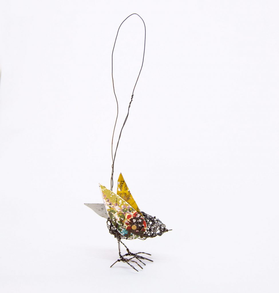 Wire and tin bird sculpture by Ingrid K Brooker. Yellow and blue wings.