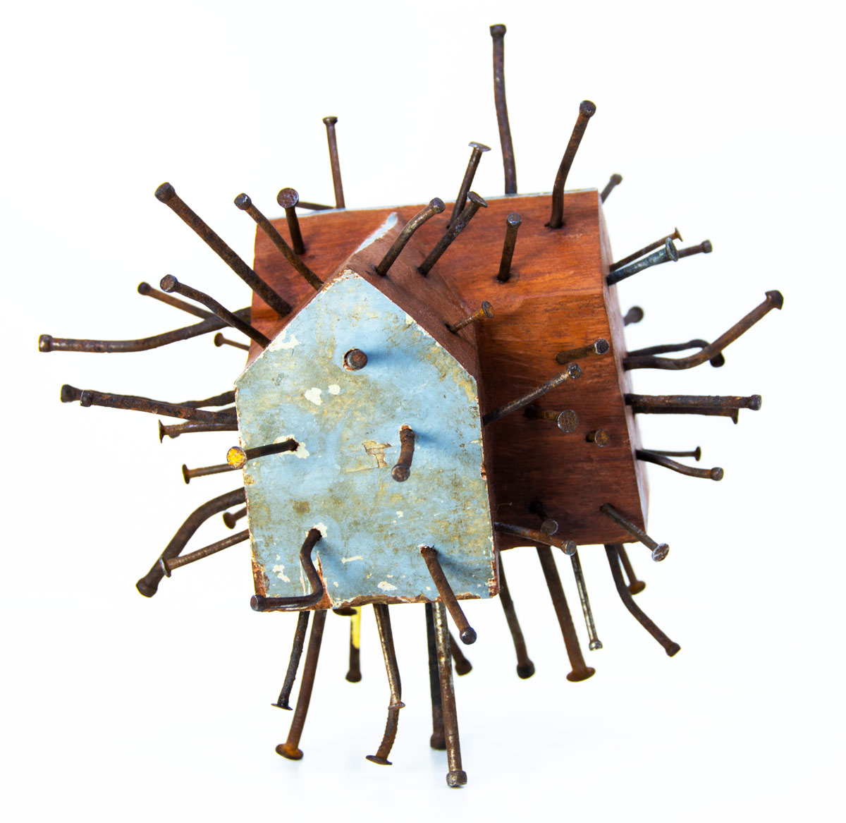Wooden house sculpture pierced with nails by Ingrid K Brooker